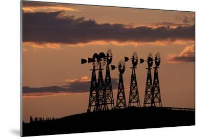 Silhouettes of Windmills Against the Sunset-Michael Forsberg-Mounted Photographic Print
