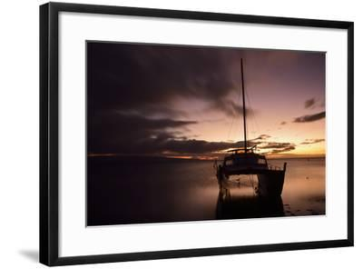 Pink Sunset over the Pacific Ocean with a Catamaran Anchored in the Foreground on Molokai, Hawaii-Jonathan Kingston-Framed Photographic Print