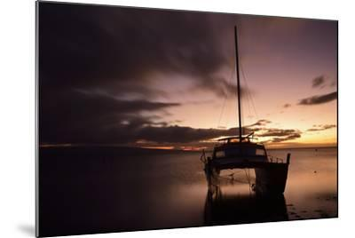 Pink Sunset over the Pacific Ocean with a Catamaran Anchored in the Foreground on Molokai, Hawaii-Jonathan Kingston-Mounted Photographic Print