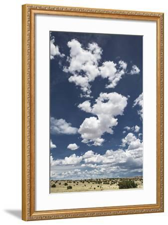Fluffy Cumulus Clouds Above Desert Landscape in Northeastern New Mexico-Kent Kobersteen-Framed Photographic Print