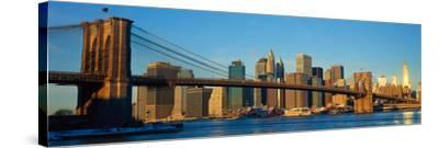 Panoramic View of Brooklyn Bridge and East River at Sunrise with New York City--Stretched Canvas Print