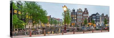 Bikes and Houses Along Canal at Dusk at Intersection of Herengracht and Brouwersgracht--Stretched Canvas Print