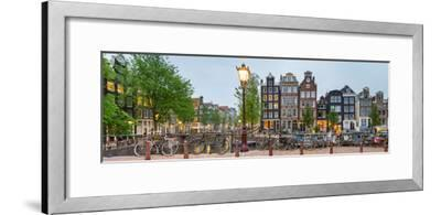 Bikes and Houses Along Canal at Dusk at Intersection of Herengracht and Brouwersgracht--Framed Photographic Print