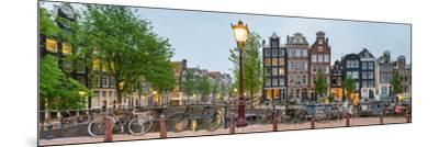 Bikes and Houses Along Canal at Dusk at Intersection of Herengracht and Brouwersgracht--Mounted Photographic Print