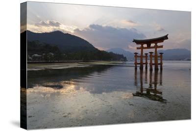 The Floating Miyajima Torii Gate of Itsukushima Shrine at Sunset-Stuart Black-Stretched Canvas Print