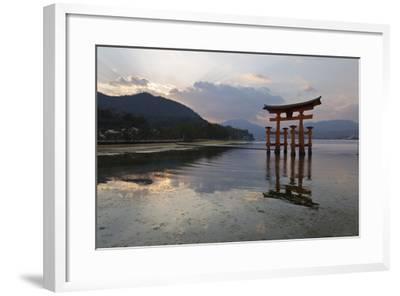 The Floating Miyajima Torii Gate of Itsukushima Shrine at Sunset-Stuart Black-Framed Photographic Print