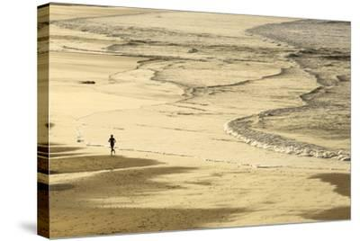 Woman Jogging at Sunrise on Gwithian Beach, Cornwall, England, United Kingdom-Mark Chivers-Stretched Canvas Print