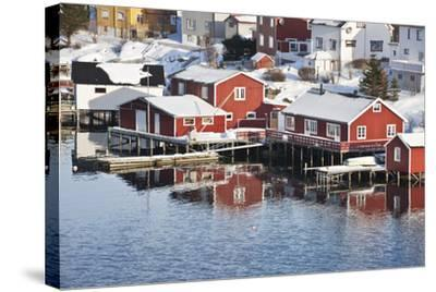 Wooden Cabins at the Waters Edge in the Town of Raine in the Lofoten Islands, Arctic, Norway-David Clapp-Stretched Canvas Print