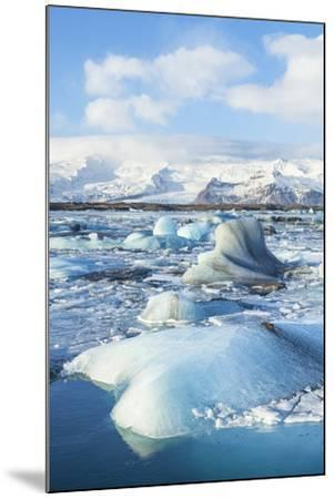 Mountains Behind the Icebergs Locked in the Frozen Water of Jokulsarlon Iceberg Lagoon-Neale Clark-Mounted Photographic Print