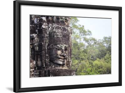 Buddha Face Carved in Stone at the Bayon Temple, Angkor Thom, Angkor, Cambodia-Yadid Levy-Framed Photographic Print