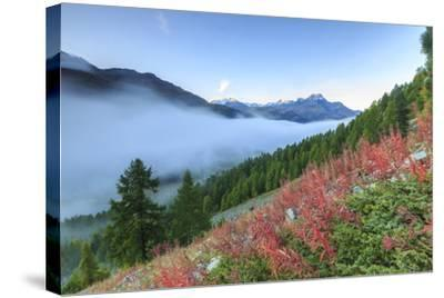 Autumn Mist Dissolving and Revealing the Top of Piz La Margna Towering over Peaks of Engadine-Roberto Moiola-Stretched Canvas Print