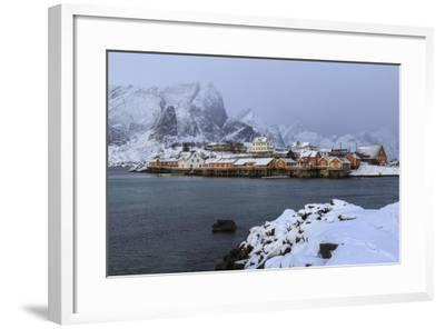 Snowy Peaks and Rorbu, the Red Houses of Fishermen, in the Landscape of the Lofoten Islands-Roberto Moiola-Framed Photographic Print