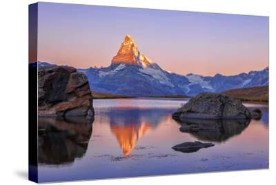 Pink Sky at Sunrise on the Matterhorn Reflected in Stellisee-Roberto Moiola-Stretched Canvas Print