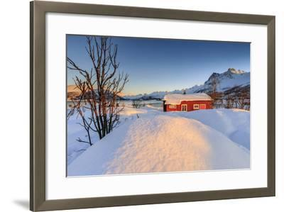 The Winter Sun Illuminates a Typical Norwegian Red House Surrounded by Fresh Snow-Roberto Moiola-Framed Photographic Print
