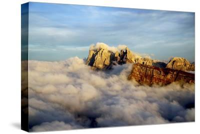 Aerial Shot from Seceda of Odle Surrounded by Clouds at Sunset in the Dolomites-Roberto Moiola-Stretched Canvas Print