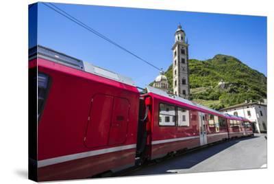 The Bernina Express Train Passes Near the Sanctuary of Madonna Di Tirano, Lombardy, Italy-Roberto Moiola-Stretched Canvas Print