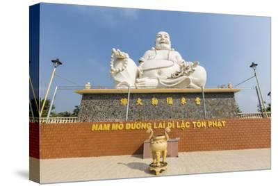 Giant Buddha Statue at Vinh Trang Pagoda, My Tho, Vietnam, Indochina, Southeast Asia, Asia-Michael Nolan-Stretched Canvas Print