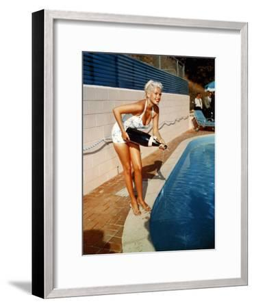 American Actress Jayne Mansfield with a Bottle of Champagne, Near a Swimming Pool, 1956-1957--Framed Photo