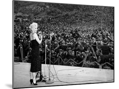 """Marilyn Monroe Named """"Member of Honour of the 25E Division"""" on February 16-19, 1954--Mounted Photo"""