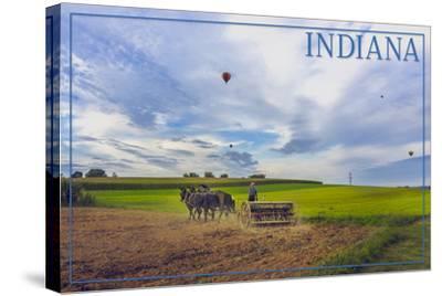 Indiana - Amish Farmer and Hot Air Balloons-Lantern Press-Stretched Canvas Print
