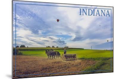Indiana - Amish Farmer and Hot Air Balloons-Lantern Press-Mounted Art Print