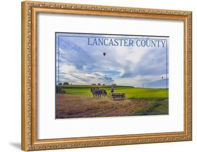 Lancaster County, Pennsylvania - Amish Farmer and Hot Air Balloons-Lantern Press-Framed Art Print