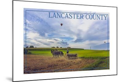 Lancaster County, Pennsylvania - Amish Farmer and Hot Air Balloons-Lantern Press-Mounted Art Print