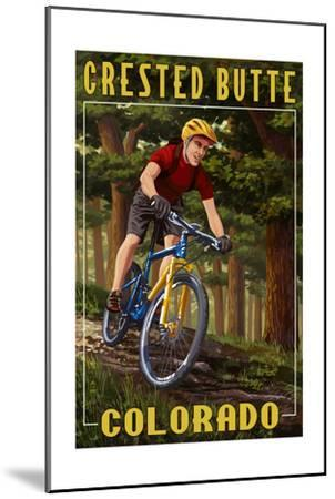 Crested Butte, Colorado - Mountain Biker in Trees-Lantern Press-Mounted Art Print
