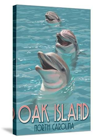 Oak Island, North Carolina - Dolphins Swimming-Lantern Press-Stretched Canvas Print