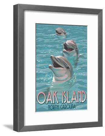 Oak Island, North Carolina - Dolphins Swimming-Lantern Press-Framed Art Print
