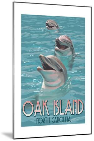 Oak Island, North Carolina - Dolphins Swimming-Lantern Press-Mounted Art Print