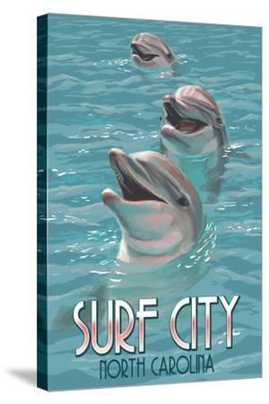 Surf City, North Carolina - Dolphins-Lantern Press-Stretched Canvas Print