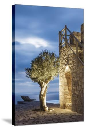 Tainaron Blue Retreat in Mani, Greece. Exterior View of an Alcove in a Stone Wall and a Tree-George Meitner-Stretched Canvas Print