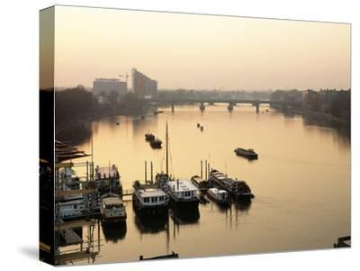 Houseboats Moored on River Thames with Putney Bridge at Sunset, Uk-Simon Warren-Stretched Canvas Print