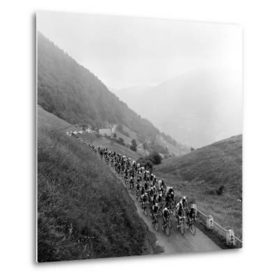 Contestants in the Grueling Tour De France are Seen on Their Way to the Mente Pass--Metal Print