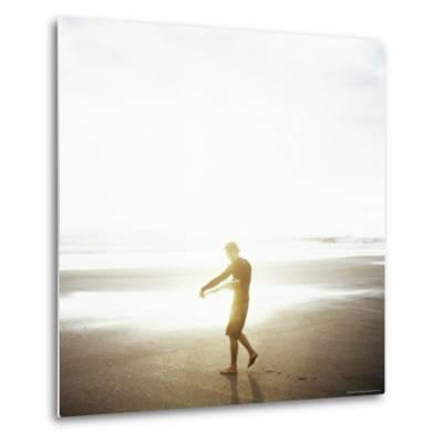 Young Man Waxes His Board Before Entering Marabella's Waves, Costa Rica, Central America-Aaron McCoy-Metal Print