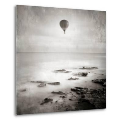 A Hot Air Balloon Floating Above the Sea-Luis Beltran-Metal Print