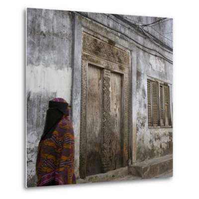 Zanzibar, Tanzania. a Zanzibari Women in Traditional Khanga Robes, Passing an Old Wooden Door in St-Steve Outram-Metal Print