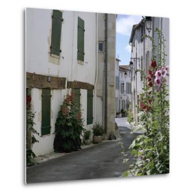Typical Street Scene with Hollyhocks, St. Martin, Ile de Re, Poitou-Charentes, France, Europe-Stuart Black-Metal Print