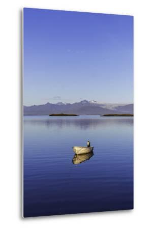 A Johnboat with An Outboard Motor and Its Reflection in Calm Blue Water-Jonathan Irish-Metal Print