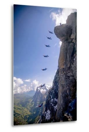 A Base Jumper Leaps Off the Mushroom, North Face of the Eiger, Bernese Oberland of the Swiss Alps-Cory Richards-Metal Print