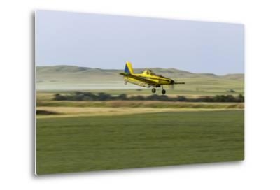 Crop Duster Airplane Spraying Farm Field Near Mott, North Dakota, USA-Chuck Haney-Metal Print