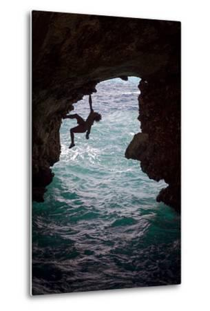 A Rock Climber Climbing Without Ropes Above the Mediterranean Sea-Cory Richards-Metal Print