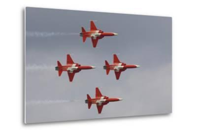 Bright Red Jets Flying in Formation At an Air Show-Joe Petersburger-Metal Print