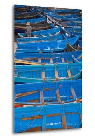 A Fisherman Stands in the Traditional Blue Boats of Essaouira Harbor-Cristina Mittermeier-Metal Print