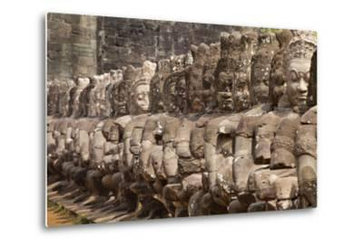 Stone Statues of Evil Line the Right Side of a Bridge At Angkor Thom-Kent Kobersteen-Metal Print
