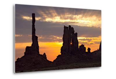 Silhouetted Totem Pole and Yei Bi Chei Rock Formations at Sunrise-Derek Von Briesen-Metal Print