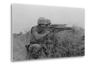 US Marine Machine Gunner and Rifleman Fire at the Enemy, Near DMZ, Vietnam, 1967--Metal Print
