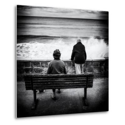 Elderly Couple Watch the Waves-Rory Garforth-Metal Print