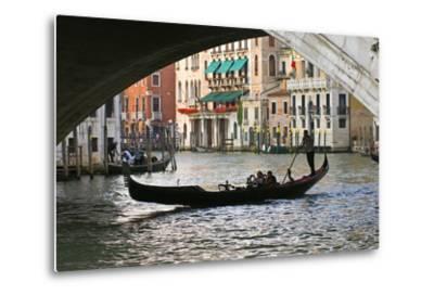 Tourist in a Gondola as They Pass under the Rialto Bridge, Venice, Italy-David Noyes-Metal Print